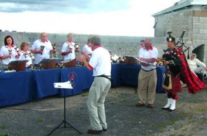 "The resident piper at Fort Henry, Kingston, Ontario, helps us perform ""Amazing Grace""."